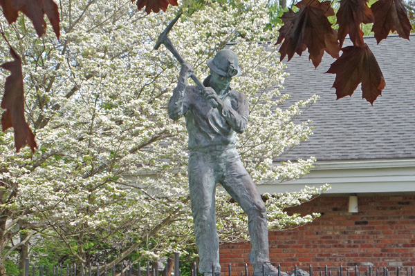 miner statue in the spring